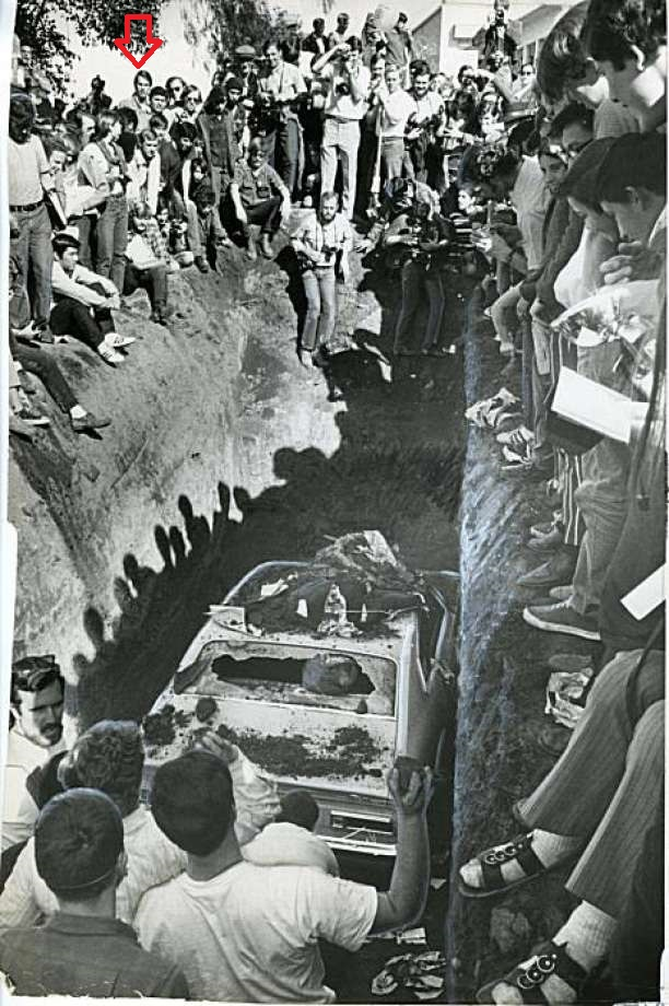 Burial of car at Survival Faire at San Jose State College 2/20/1970